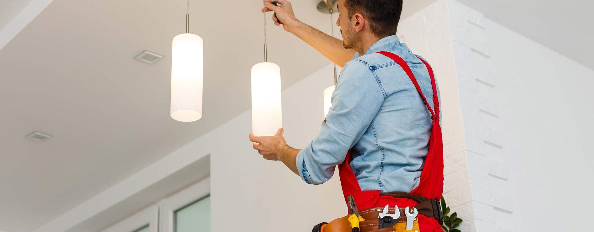 Electrian Installing Light Fixtures